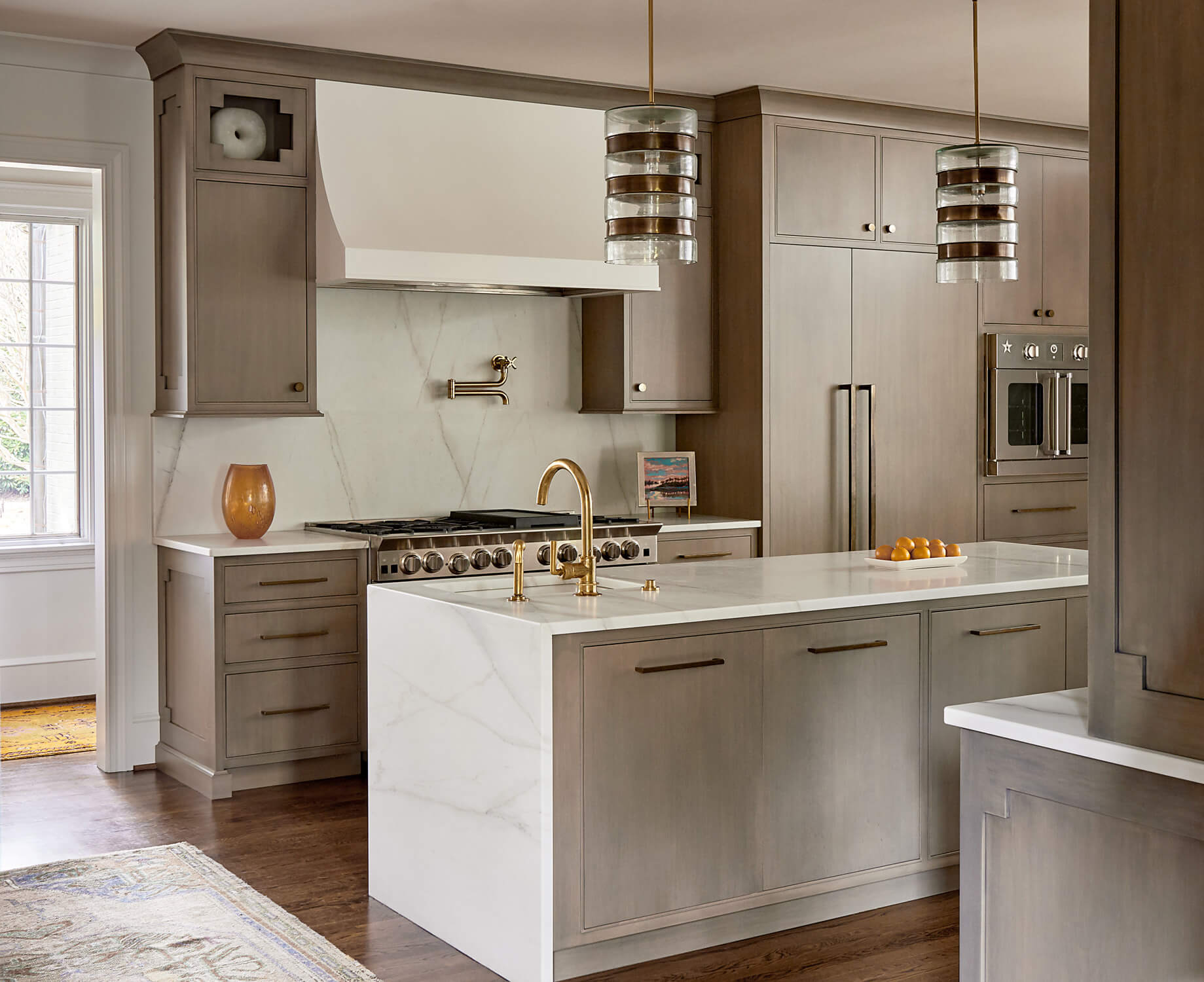 large center island with waterfall edge countertop