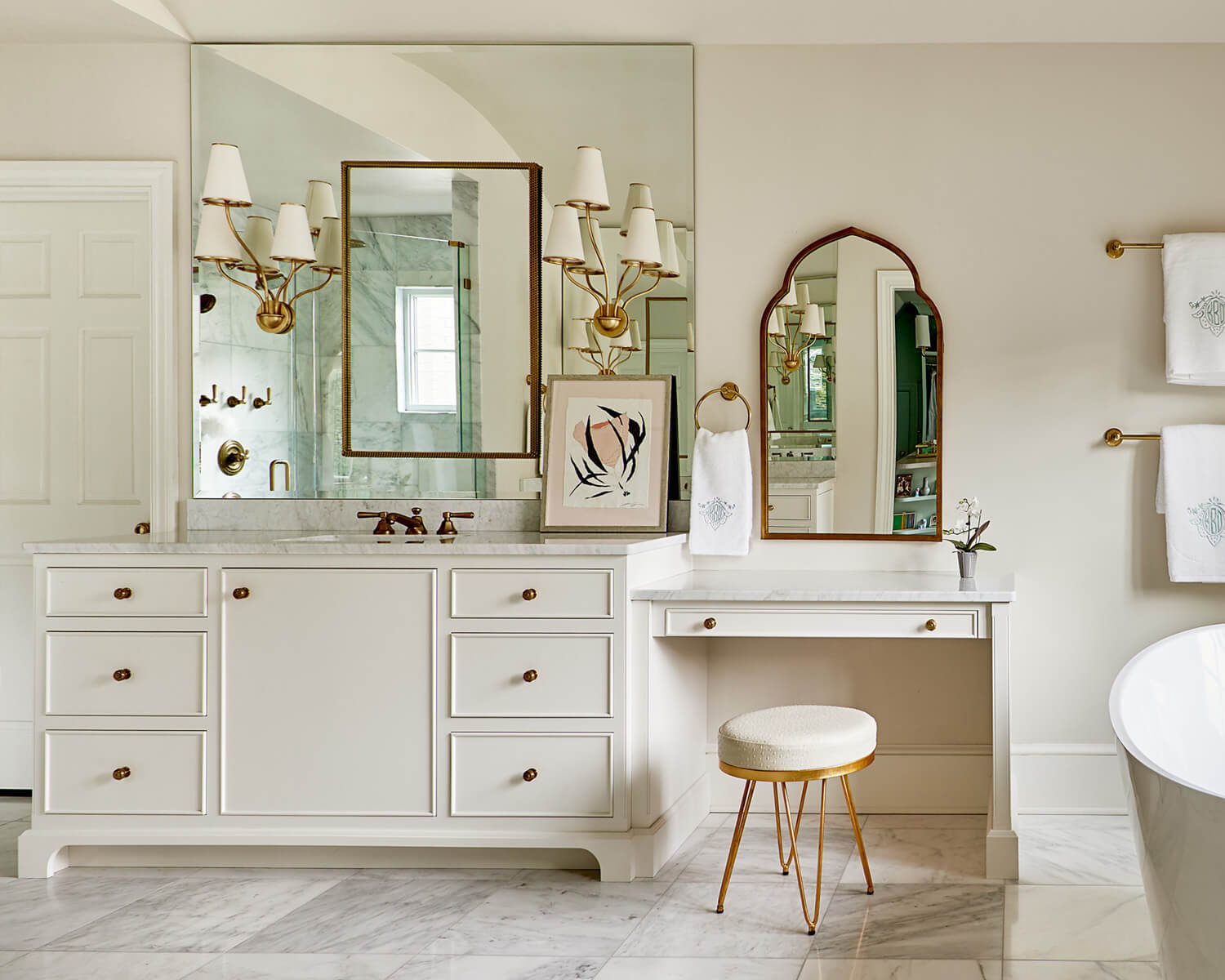 Bathroom remodel using custom white cabinetry by Bistany Design