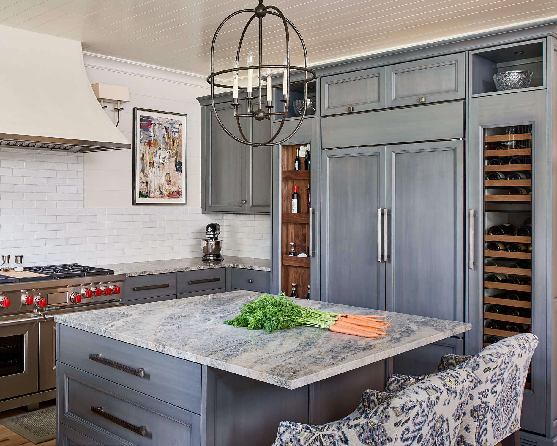 Blue stained cabinetry and custom appliance panels